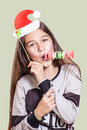 A young, pretty girl depicts Santa Claus Royalty Free Stock Photo