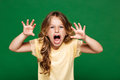 Young pretty girl frightening over green background. Royalty Free Stock Photo