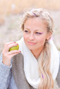 Young pretty girl holding apple outdoors caucasian woman smiling and green Royalty Free Stock Photos