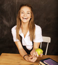 Young pretty girl student in classroom at blackboard Royalty Free Stock Photo