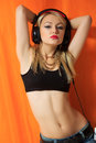 Young pretty hipster woman listening music and dancing big headphones on your phone Royalty Free Stock Image