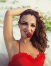 Young pretty hispanic woman on seacoast with flying hair, hot se Royalty Free Stock Photo