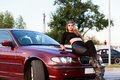 Young pretty lady with a clasic car in parking Stock Image