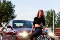 Young pretty lady with a clasic car in parking Royalty Free Stock Images