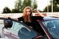 Young pretty lady with a clasic car in parking Stock Photos