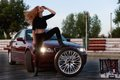 Young pretty lady with a clasic car in parking Royalty Free Stock Photo
