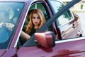 Young pretty lady with a clasic car in parking Stock Images