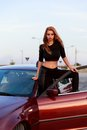 Young pretty lady with a clasic car in parking Royalty Free Stock Photography