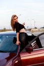 Young pretty lady with a clasic car in parking Royalty Free Stock Photos