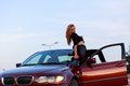 Young pretty lady with a clasic car in parking Stock Photo