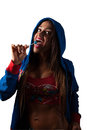 Young pretty latino woman eating a lolly pop working out and Royalty Free Stock Photos