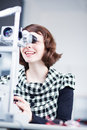 Young pretty optometrist using a slit lamp Royalty Free Stock Photos