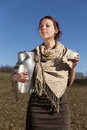 Young pretty peasant woman drinking fresh milk is Royalty Free Stock Photography