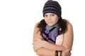 Young pretty pre teen girl brunette being cold wearing a wool cap and scarf on a white background Stock Image