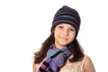 Young pretty pre teen girl brunette smiling wearing a wool hat and scarf on a white background Royalty Free Stock Images