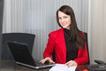 Young pretty smiling business woman with notebook in the office Stock Images