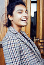 Young pretty student teenage indian girl in doors happy smiling, having fun, lifestyle people concept Royalty Free Stock Photo