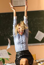 Young pretty teacher screaming in the class room Stock Image