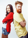 Young pretty teenage couple, hipster guy with his girlfriend happy smiling and hugging isolated on white background Royalty Free Stock Photo