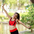 Young pretty woman doing yoga exercises in park the Stock Photography