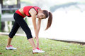Young pretty woman doing yoga exercises in park the Royalty Free Stock Images