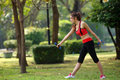 Young pretty woman doing yoga exercises in park the Royalty Free Stock Photo
