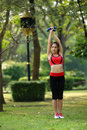 Young pretty woman doing yoga exercises in park the Stock Image