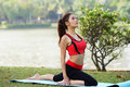 Young pretty woman doing yoga exercises in park the Stock Photos