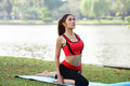 Young pretty woman doing yoga exercises in park the Stock Images