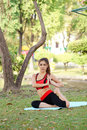 Young pretty woman doing yoga exercises in park the Royalty Free Stock Photography
