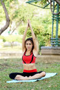 Young pretty woman doing yoga exercises in park the Royalty Free Stock Photos