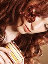 Young pretty woman drinking coffee curly Stock Images