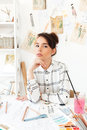 Young pretty woman fashion designer sitting at her work desk Royalty Free Stock Photo