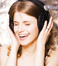 Young pretty woman in headphones listening music, singing a song happy smiling, lifestyle people concept Royalty Free Stock Photo