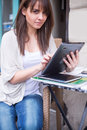 Young pretty woman holding ipad looking away close up Stock Images
