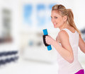 Young pretty woman holding weights and doing body training indoor Stock Photos