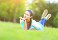 Young pretty woman lying on the grass at summer sunset Royalty Free Stock Photo