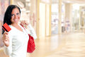 Young pretty woman in shopping center with credit card Stock Photography