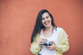 Young pretty woman taking picture with old camera Royalty Free Stock Photo
