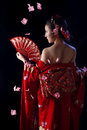 Young pretty woman wearing red kimono Royalty Free Stock Photo