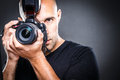 Young, pro male photographer in his studio during a photo shoot Royalty Free Stock Photo
