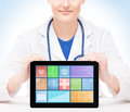 Young and professional woman doctor with an ipad Royalty Free Stock Photo