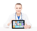 Young and professional woman doctor with an ipad medical showing a tablet pc tile design technology concept Royalty Free Stock Photo