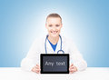 Young and professional woman doctor with an ipad medical showing a tablet pc tile design technology concept Royalty Free Stock Images