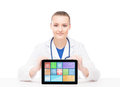 Young and professional woman doctor with an ipad medical showing a tablet pc tile design technology concept Stock Image