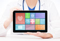 Young and professional woman doctor with a tablet Royalty Free Stock Photo