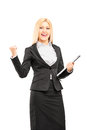Young professional woman holding a clipboard and gesturing happiness isolated on white background Stock Image