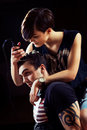 Young punk girl cuts her boyfriend using clippers Stock Photography