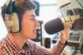 Young radio host broadcasting in studio close up of Royalty Free Stock Photos
