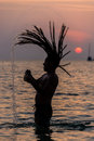 Young rastafari male playing in tropical island su youn sunset thailand south east asia adventure Royalty Free Stock Image